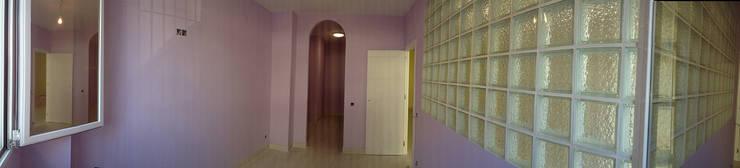 Cambio de uso de local comercial a vivienda: Dormitorios de estilo  de AtelierBas. Arquitectura y Construcción