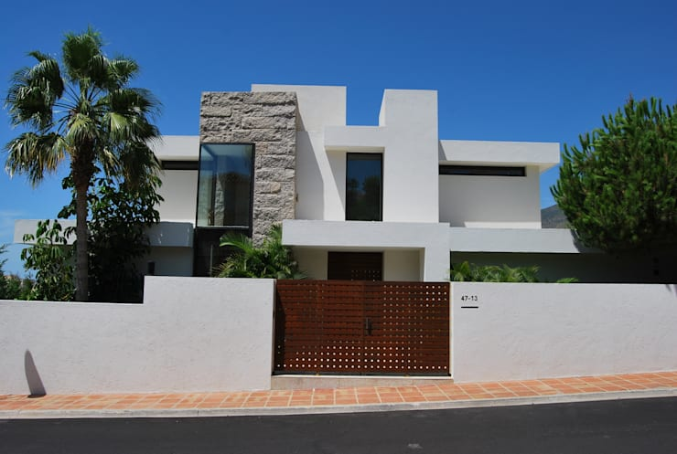 Casas de estilo  por saz arquitectos