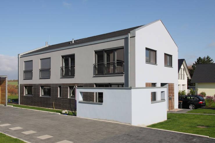 Casas de estilo  por skt umbaukultur Architekten BDA, Moderno