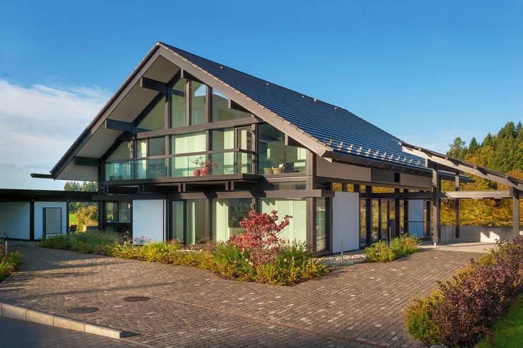 Casas de estilo moderno por HUF HAUS GmbH u. Co. KG