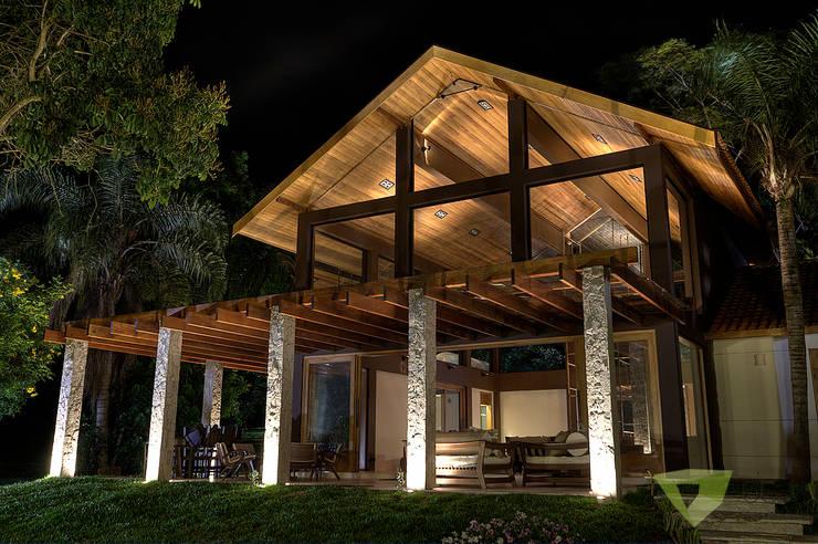 Casa de Campo Quinta do Lago - Tarauata: Casas campestres por Olaa Arquitetos