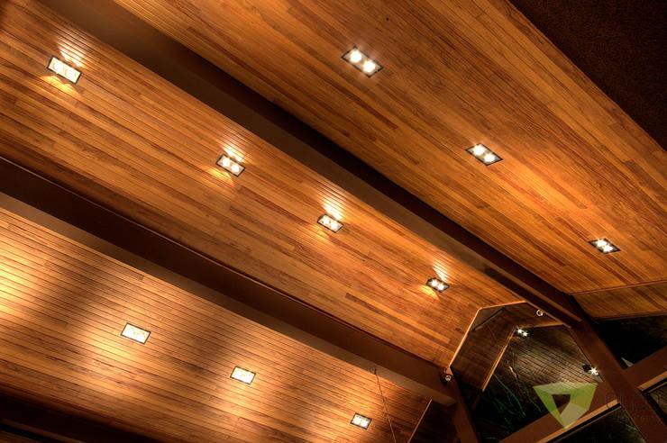 Casa de Campo Quinta do Lago - Tarauata: Salas de estar  por Olaa Arquitetos