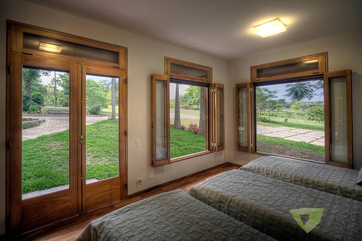 Casa de Campo Quinta do Lago - Tarauata: Quartos  por Olaa Arquitetos
