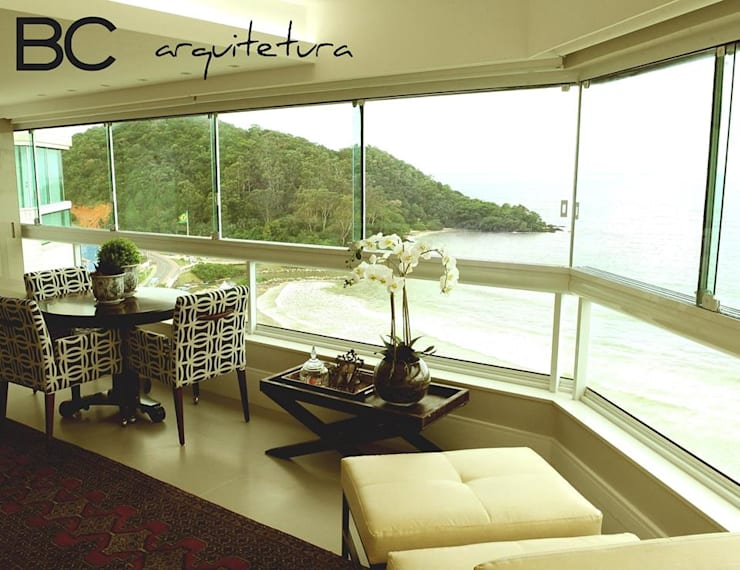 Apartamento elegante a beira mar: Jardins de inverno  por Bruna Zappelini Arquitetura