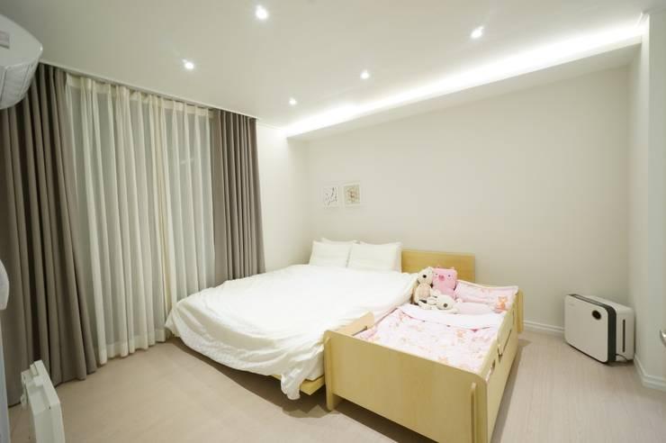 수완진아리채 3차 After: 유노디자인의  침실
