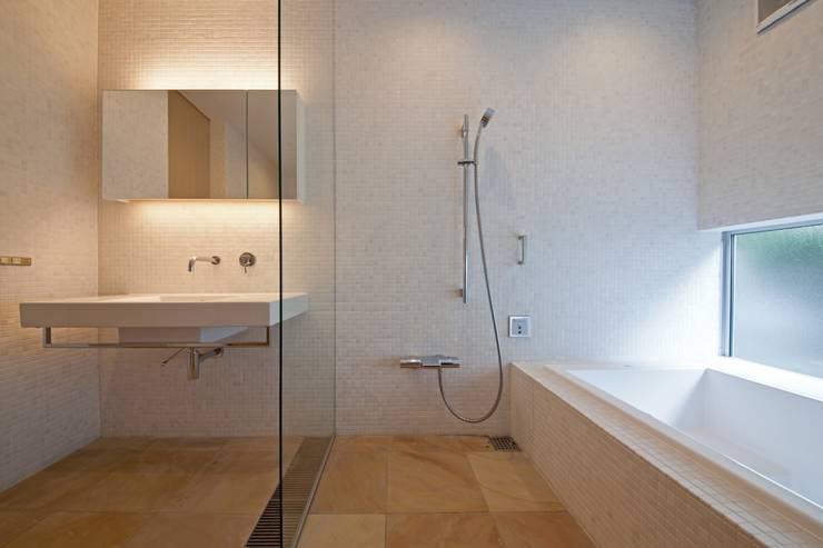 ホテルライクなバスルーム: 根岸達己建築室が手掛けた浴室です。,
