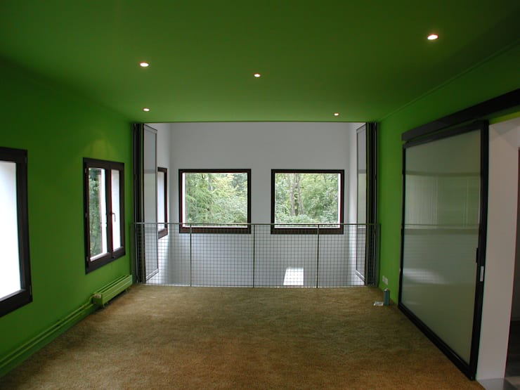 Transformation d'une ferme avicole en logement: Salon de style  par [GAA] GUENIN Atelier d'Architectures SA
