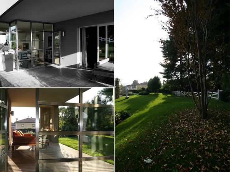 Villa bifamiliare: Terrazza in stile  di Studio Maggiore Architettura, Moderno