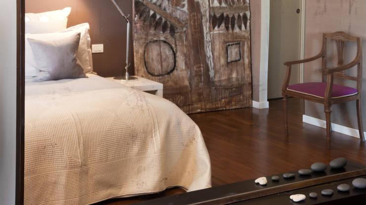 Appartamento ad Ostiense - Roma: Camera da letto in stile  di Archifacturing, Moderno