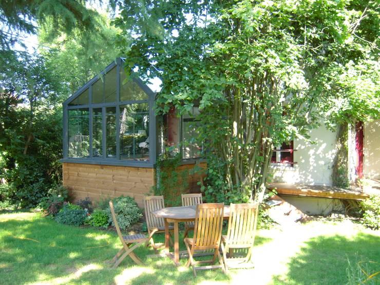 agrandissement maison Gagny : Terrasse de style  par garnault