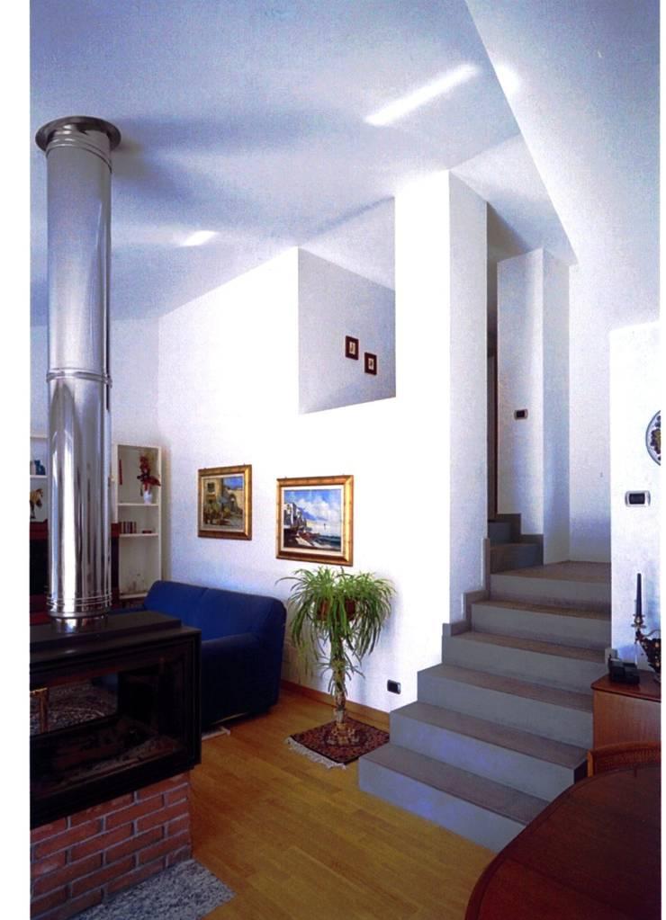 AMPLIAMENTO CASA UNIFAMILIARE: Case in stile  di BORGHI ARCHITECT& PARTNERS