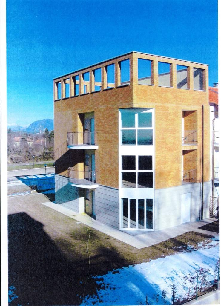 COMPLESSO RESIDENZIALE AD APPARTAMENTI: Case in stile  di BORGHI ARCHITECT& PARTNERS, Moderno