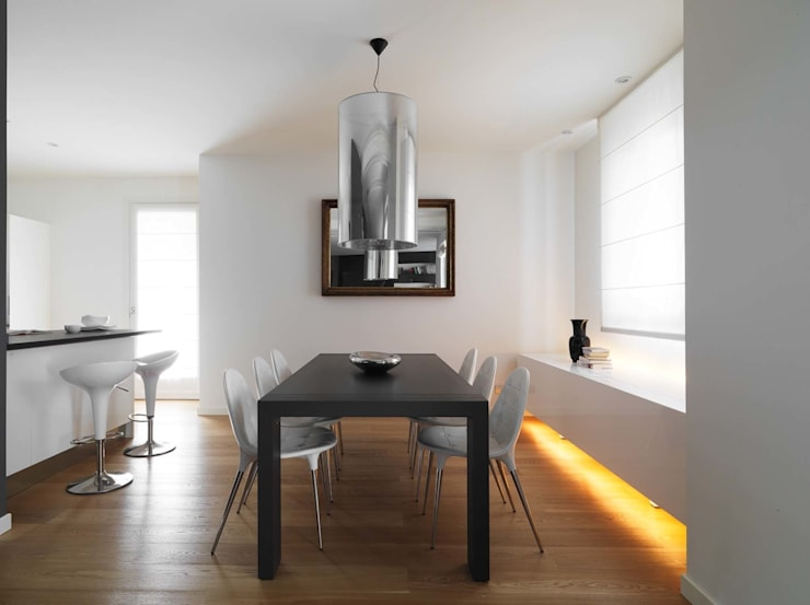 minimalistic Dining room by SANSON ARCHITETTI