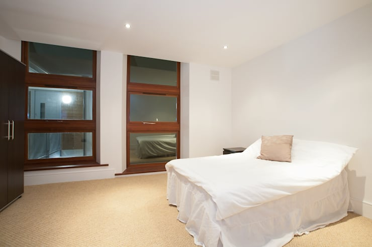 Granit Architects: minimal tarz tarz Yatak Odası
