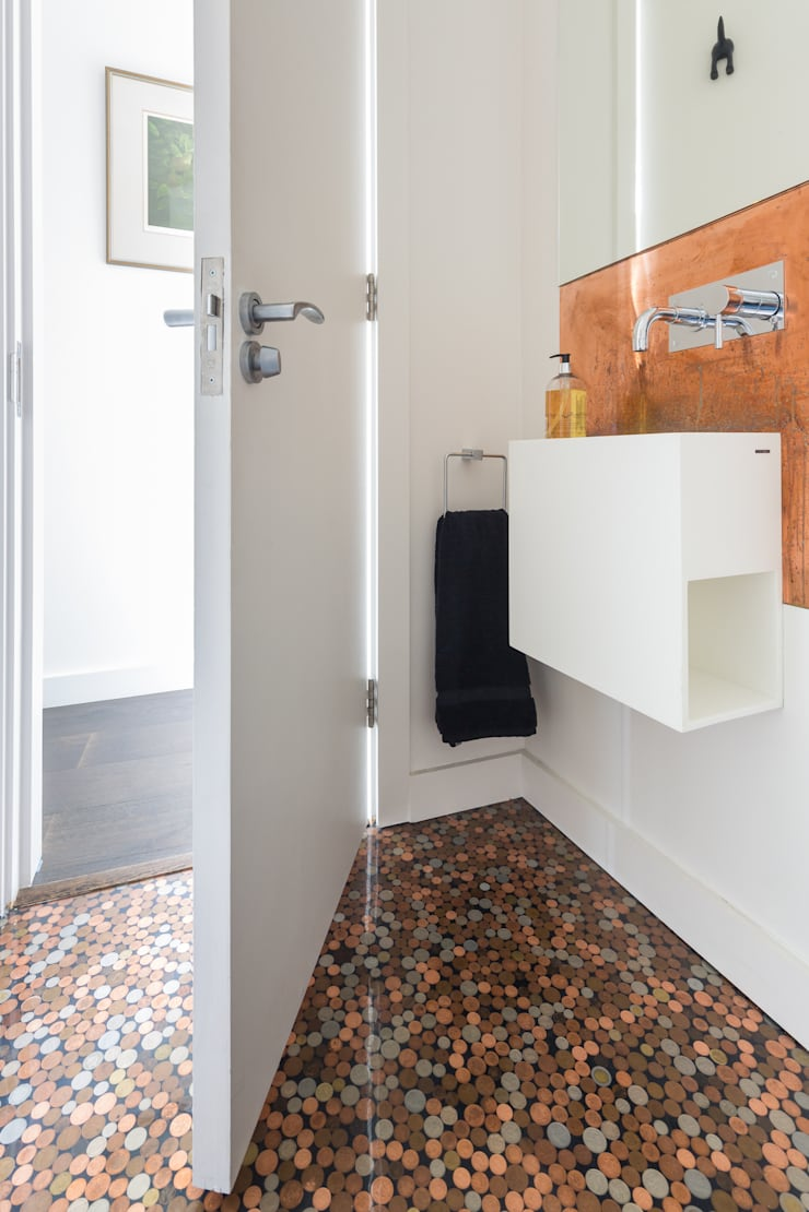 Green Retrofit, Lambourn Road:  Bathroom by Granit Architects