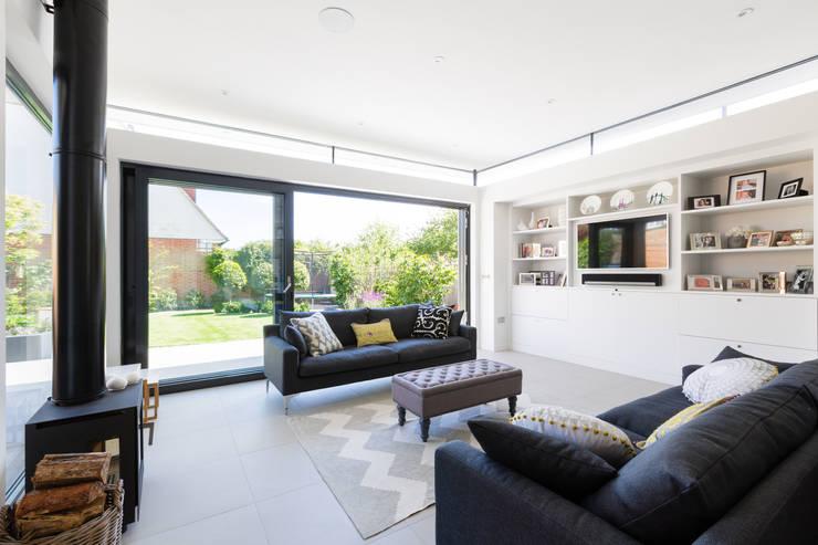 Salas de estar  por Granit Architects