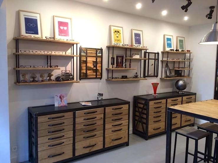 Agencement magasin d'optique - Nantes: Locaux commerciaux & Magasins de style  par MICHELI Design