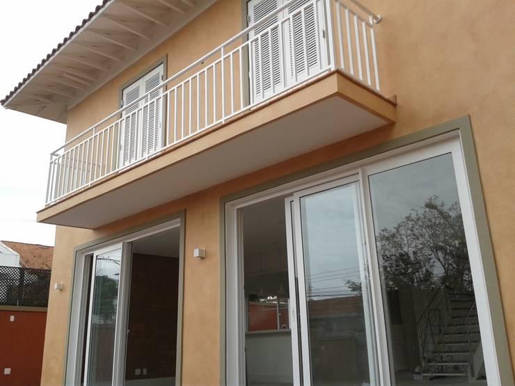 Residência Marituba: Casas  por Rachel Nakata Arquitetura