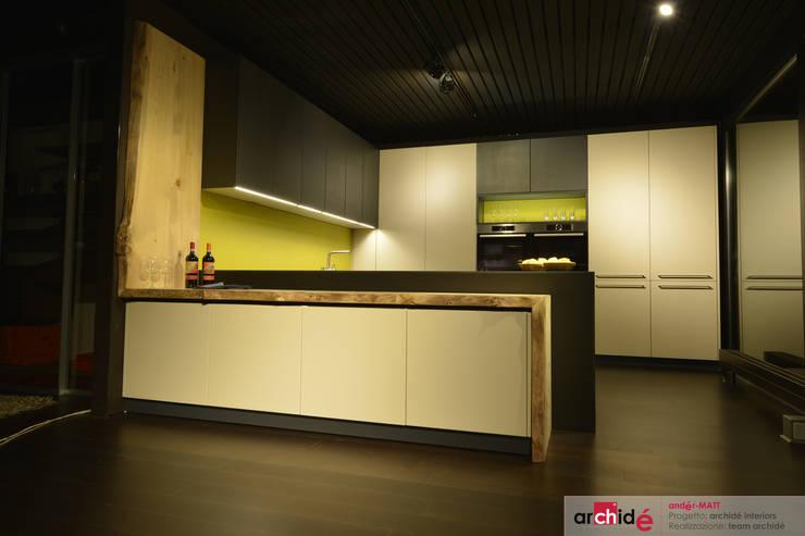 the <q>andér-MATT</q> project (showroom 2015) : Cucina in stile  di Archidé SA interior design, Minimalista