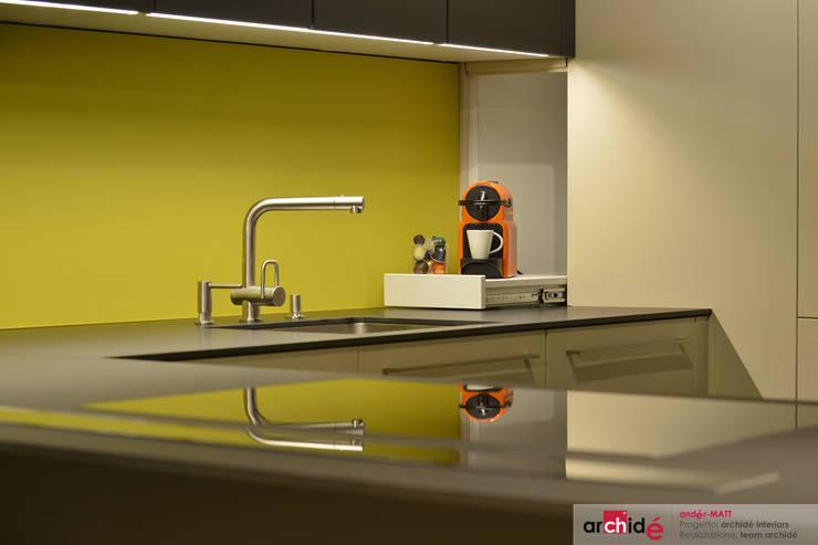 the <q>andér-MATT</q> project (showroom 2015) :  in stile  di Archidé SA interior design, Minimalista