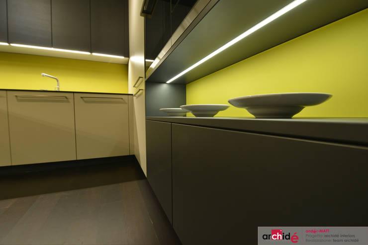 "the ""andér-MATT"" project (showroom 2015) : Cucina in stile  di Archidé SA interior design"