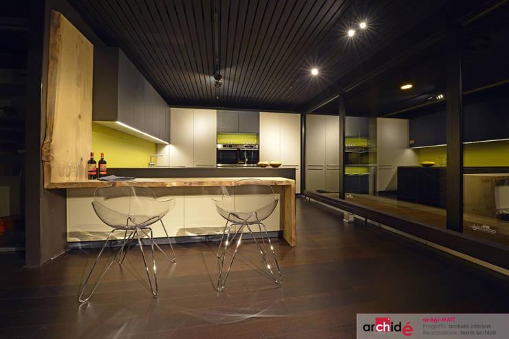 "the ""andér-MATT"" project (showroom 2015) : Cucina in stile  di Archidé SA interior design, Minimalista"
