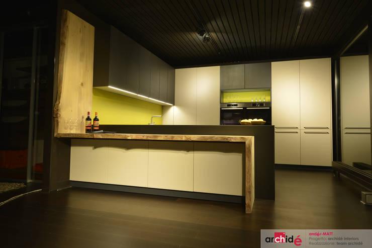the <q>andér-MATT</q> project (showroom 2015) : Cucina in stile  di Archidé SA interior design, Rustico