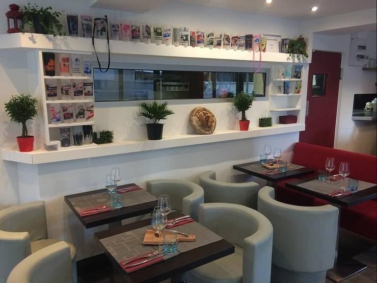 Détail du rez-de-chaussée après les travaux (centre de la salle).: Restaurants de style  par Anne Gindre Décoratrice d'Intérieur