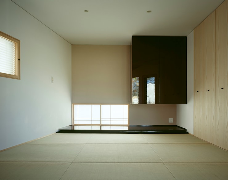 Villa Boomerang / 八ヶ岳の別荘: 森吉直剛アトリエ/MORIYOSHI NAOTAKE ATELIER ARCHITECTSが手掛けた寝室です。