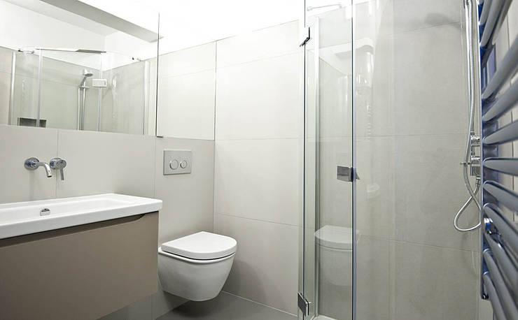 Baños de estilo  por Porcel-Thin