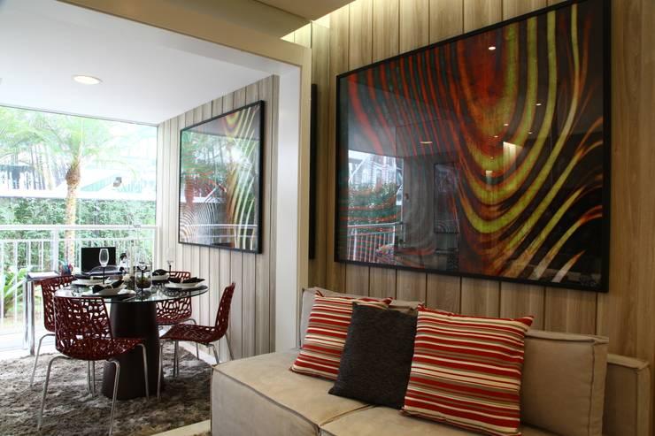 AAM_Urbe Paulista 36m²: Salas de estar  por Chris Silveira & Arquitetos Associados