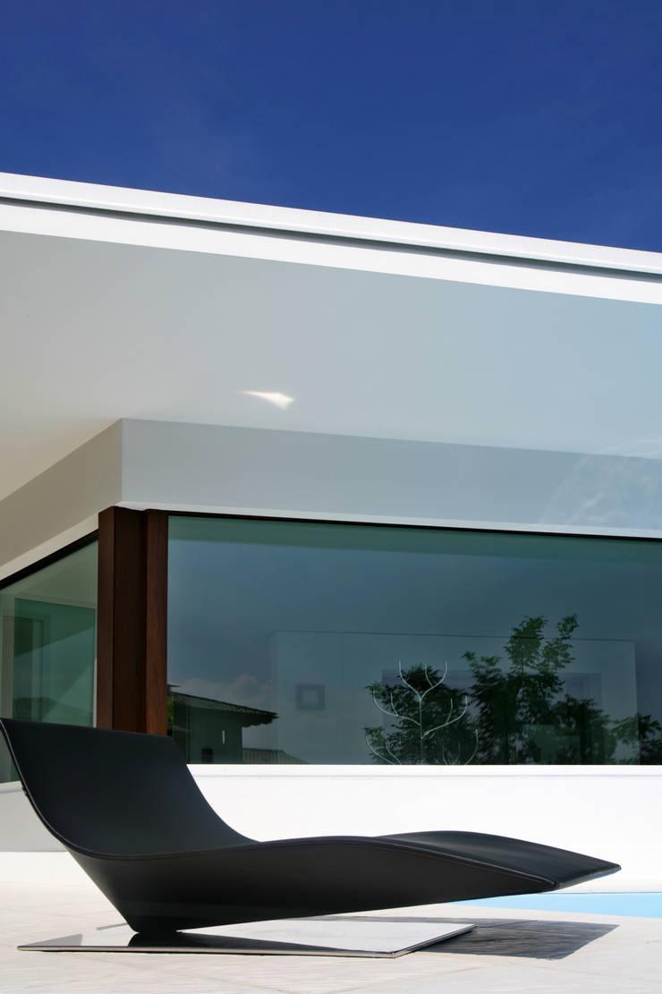 Casa C: Case in stile  di Damilano Studio