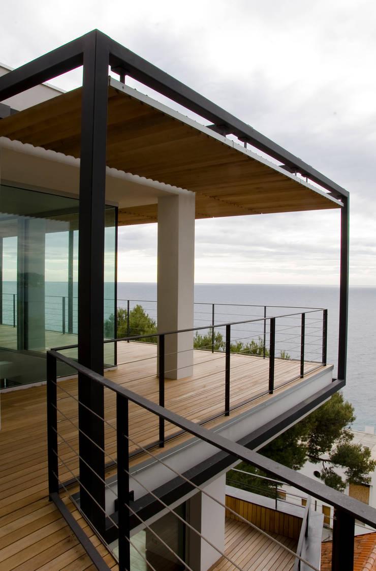 Lo spigolo della penthouse al piano alto.: Case in stile  di Studio 4