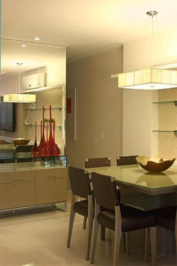 Apartamento Jardim Oceânico: Salas de jantar modernas por Cadore Arquitetura