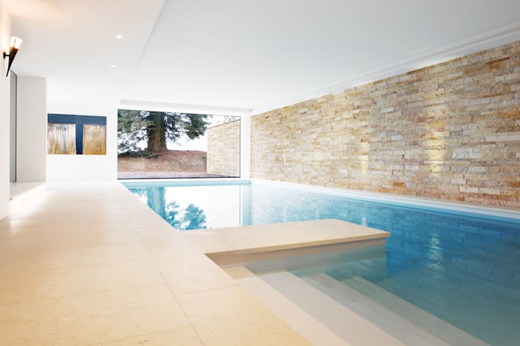modern Pool by Förstl Naturstein