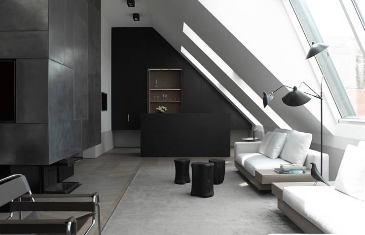 Dachgeschossausbau 2014: klassische Wohnzimmer von bernd gruber kitzbühel