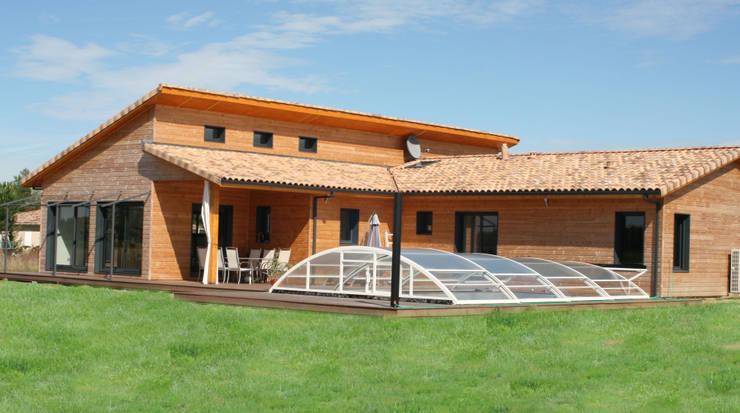 Maison individuelle ossature bois: Maisons de style  par i Petra France