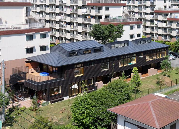 屋上庭園のある保育園(俯瞰): ユニップデザイン株式会社 一級建築士事務所が手掛けた学校です。