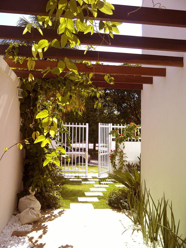 muro: Casas  por Margareth Salles