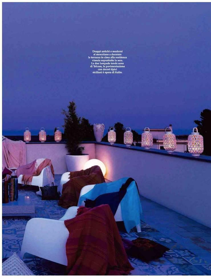 Dalla Palma pg.2: Terrazza in stile  di Mobilificio Marchese,