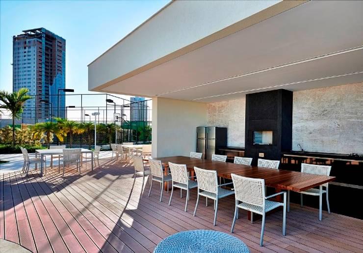Ed. Residencial Green Garden: Terraços  por Alessandra Contigli Arquitetura e Interiores