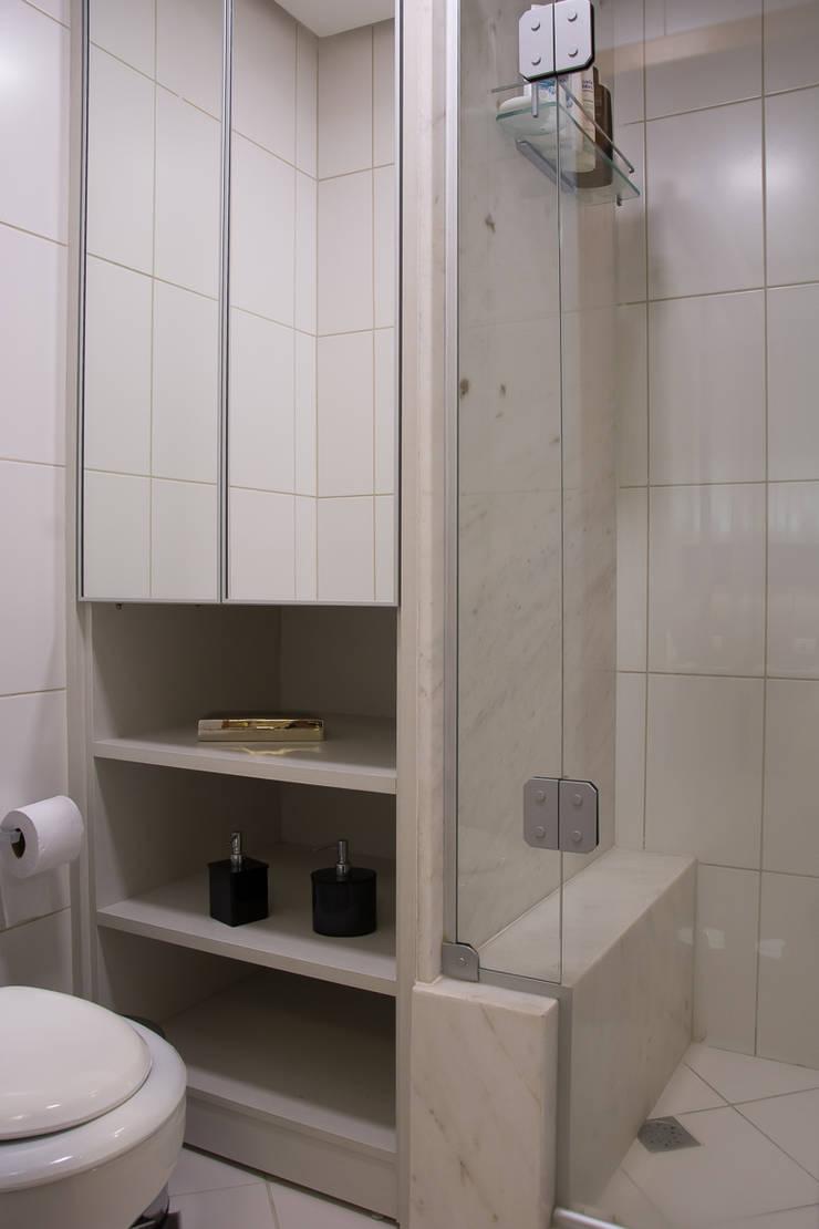 Apartamento Passo D´Areia: Banheiros  por Bibiana Menegaz - Arquitetura de Atmosfera