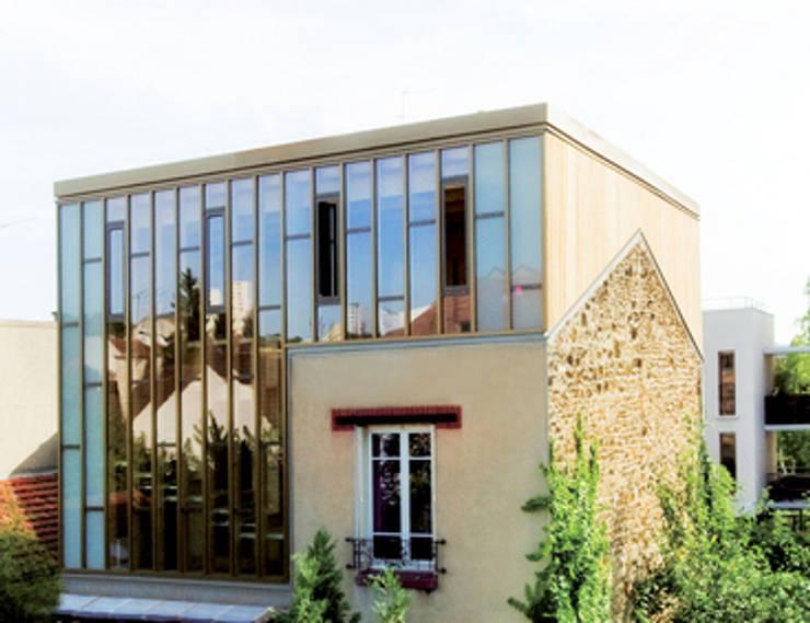 Surélévation d'une maison individuelle Montreuil:  de style  par aparchitecture