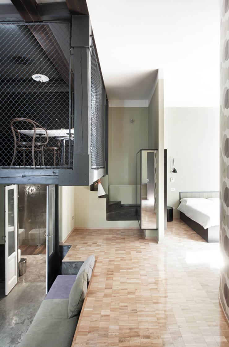 concoct: Hotel in stile  di andrea borri architetti, Moderno
