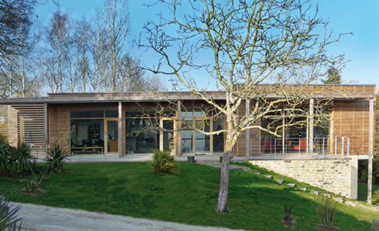 Façade Sud: Maisons de style  par Gilles Cornevin SARL