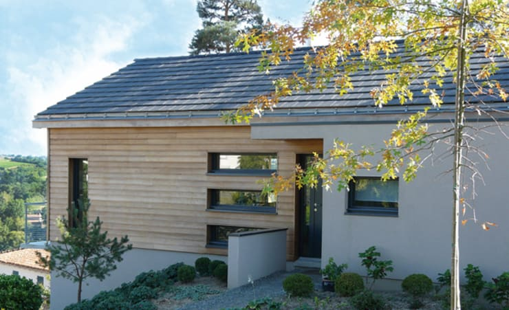 Maison C: Maisons de style  par Gilles Cornevin SARL