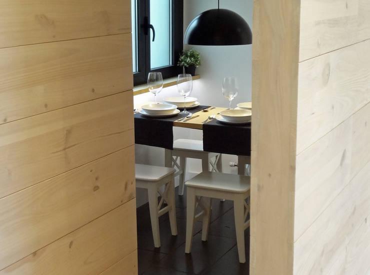 Cocina abierta al salón: Cocinas de estilo  de davidMUSER building & design