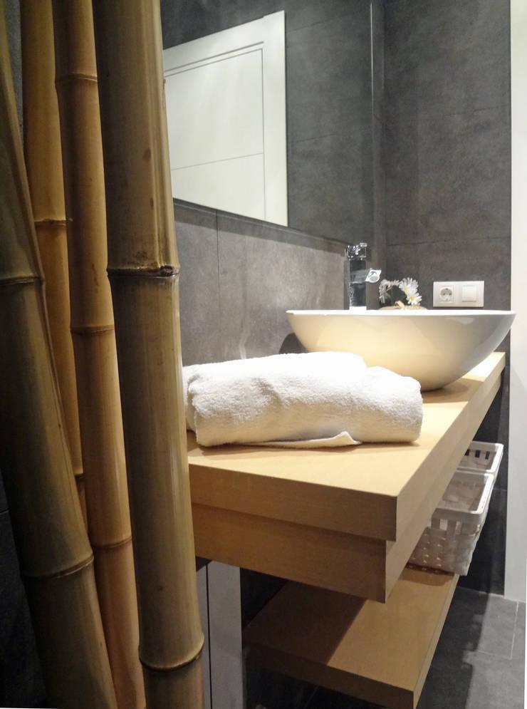 Mueble baño: Baños de estilo  de davidMUSER building & design