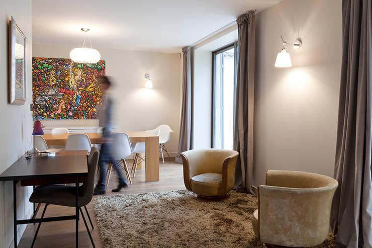 Maison à Francheville: Salle à manger de style  par Tymeno