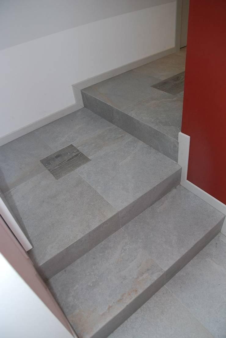 Appartamento – RSM: Ingresso & Corridoio in stile  di Fersini Marco - Pavimenti e Rivestimenti interni ed esterni, Moderno